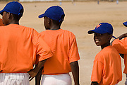Ghanaian children stand by a dirt baseball diamond as they wait for the game to start  in Tema, roughly 35 km east of Ghana's capital Accra on Saturday February 3, 2007. The exhibition game was being held on the occasion of the visit of a delegation from the American Major League Baseball Association made possible by the African Development Foundation, a non-profit organization that supports little league projects in selected African countries.