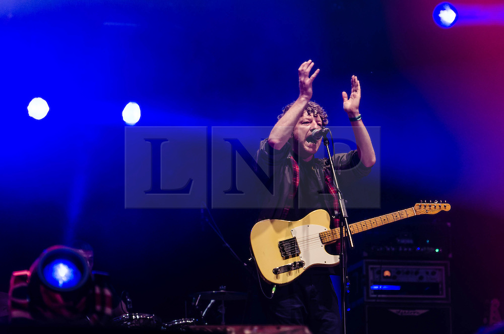 """© Licensed to London News Pictures. 31/07/2012. London, UK.  Cast perform live at BT London Live, Hyde Park.  Cast are an English rock band from Liverpool, formed in 1992 by John Power (vocals, guitar) and Peter Wilkinson (backing vocals, bass), Liam """"Skin"""" Tyson (guitar) and Keith O'Neill (drums).  In this pic John Power.  Photo credit : Richard Isaac/LNP"""