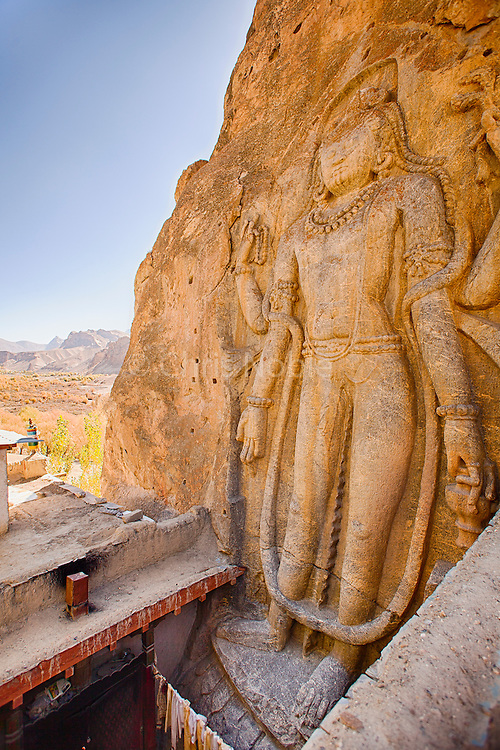 "Dating from the 8th-9th Century, a nine meter tall relief statue of ""Maitreya,"" the future buddha, carved in a cliff face in Mulbek, Ladakh India."