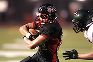Linn-Mar's Jacob Hutchins (88) protects the ball after a catch during the game between Cedar Rapids Kennedy and Linn-Mar at Linn-Mar Stadium in Marion on Friday evening, September 2, 2011. It was 35-7 Linn-Mar at halftime.