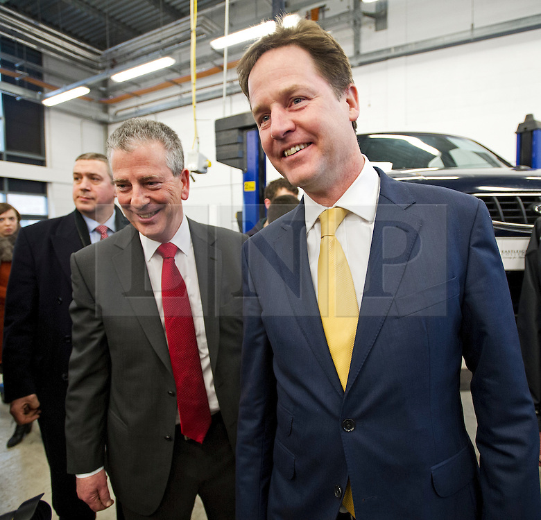 © London News Pictures. 11/02/2013 . Eastleigh, UK.  Leader of the Liberal Democrat Party, NICK CLEGG (right)  with the Liberal Democrat candidate for the Eastleigh by-election MIKE THORNTON (left) speaking to automotive studies students during a visit to Eastleigh College in Eastleigh, Hampshire on February 11, 2013. The by-election was called when the former MP for Eastleigh, Chris Hune, resigned after admitting perverting the course of justice. Photo credit : Ben Cawthra/LNP