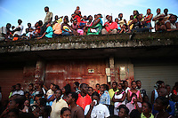 A crowd watches a religious parade in Quibdo, the capital of the state of Choco, on October 4, 2006. Choco is a state that has suffered terribly at the hands of both rightwing paramilitaries and leftist rebels over the years, causing many to flee to other parts of Colombia. The Choco is located on the Pacific coast of Colombia and most of the people are black descendants of African slaves. (Photo/Scott Dalton)