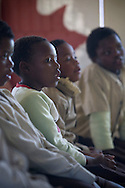 Orphaned children pictured during a class being taken by students from Waterford Kamhlaba college at a school at Mpolongeni, Swaziland. The Kingdom of Swaziland (population 1.1m), a small, landlocked country in southern Africa was bordered by South Africa on three sides and Mozambique to the east, with Mbabane as its administrative capital. At the start of the 21st century, the country had the highest incidence per head of population of HIV/Aids in the world and and high levels of poverty mainly in rural areas where 75 per cent of the population lived.