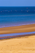 Sandy beach of red soil along the Gulf of St. Lawrence
