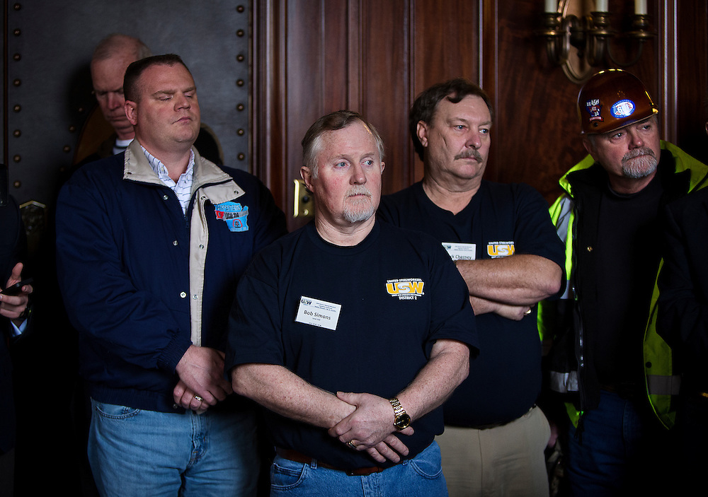 MADISON, WI — FEBRUARY 25: United Steel Workers union members listen intently during a press conference in the Wisconsin State Capitol before an extraordinary session to discuss a proposed right-to-work legislation.
