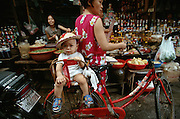 Hom Market. Baby on a bike.