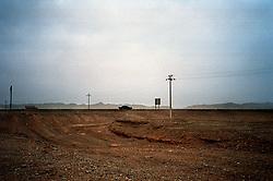 Gobi Desert,China<br /> A car driving through the desert from Urumqui to Turpam.<br /> &copy;Carmen Secanella.