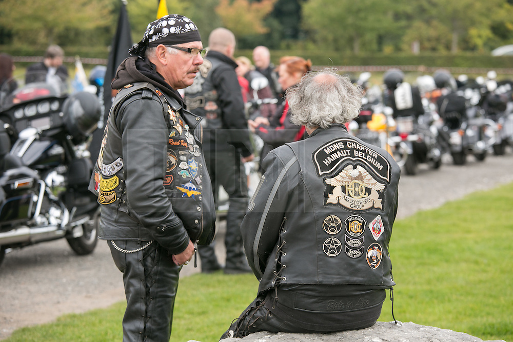 "© Licensed to London News Pictures. 3/10/2015, Tamworth, Staffordshire, UK. The eighth Ride to the Wall ""RTTW"" took place today with thousands of motorcyclists arriving at the National Memorial Arboretum. Starting at eleven designated points around the country, the riders came from all over the UK as well as continental Europe.They rode to visit the walls of the Armed Forces Memorial where the names of 16,000 service men and women are engraved to remember those killed on duty or by terrorist action since the end of the Second World War. A display by the white helmets, tiger moth flypast and memorial service formed part of the day. Pictured, riders from Belgium taking part in the ride. Photo credit / Dave Warren/LNP"