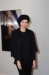 DANNII MINOGUE at a private view of Atelier-Mayer.com's collection held at 131 Oakwood Court, London, on 24th November 2009.