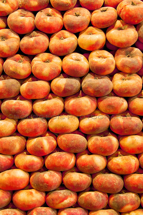 Donut Peach aka Saturn Peach were found in plethora around the towns and streets of Barcelona Spain. They were quite a tasty fruit.