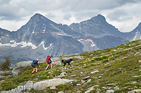 Two female hikers with black dog on Abbott Ridge Trail. Selkirk Mountains Glacier National Park British Columbia