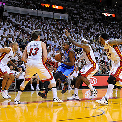 Jun 17, 2012; Miam, FL, USA; Oklahoma City Thunder small forward Kevin Durant (35) drives past Miami Heat small forward LeBron James (6) as small forward Shane Battier (31), shooting guard Mike Miller (13), and power forward Udonis Haslem (40) close in on defense during the first quarter in game three in the 2012 NBA Finals at the American Airlines Arena. Mandatory Credit: Derick E. Hingle-US PRESSWIRE