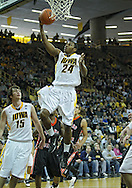 December 04 2010: Iowa Hawkeyes guard Bryce Cartwright (24) puts up a shot during the second half of their NCAA basketball game at Carver-Hawkeye Arena in Iowa City, Iowa on December 4, 2010. Iowa won 70-53.