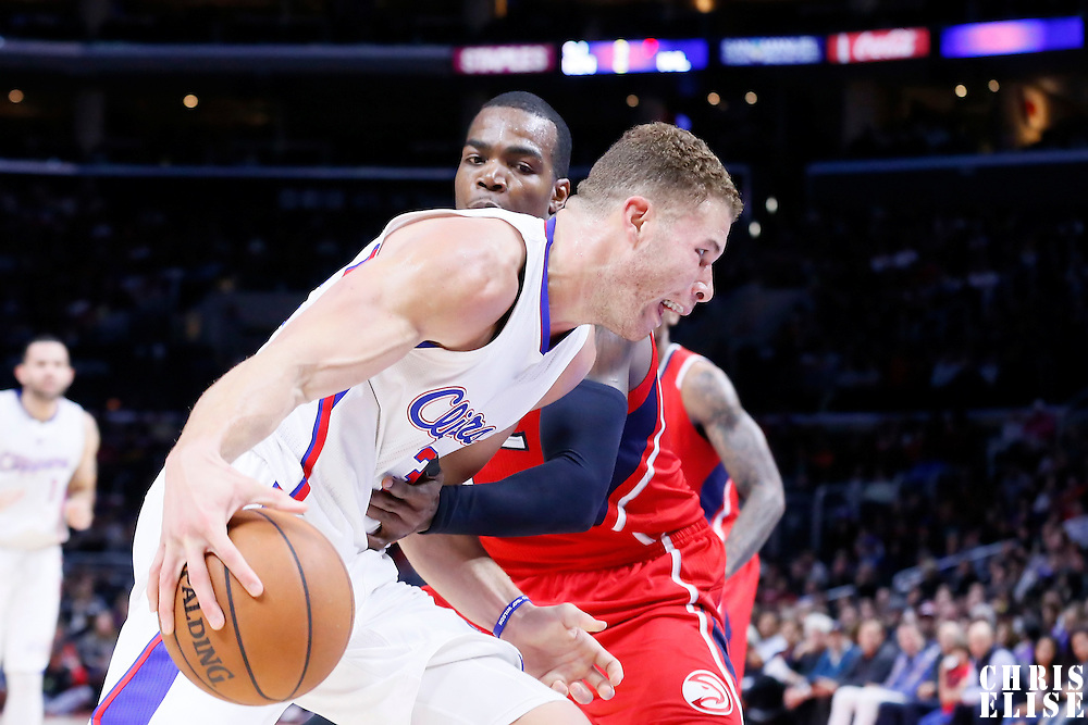 05 January 2014: Los Angeles Clippers forward Blake Griffin (32) drives past Atlanta Hawks forward Paul Millsap (4) during the Atlanta Hawks 107-98 victory over the Los Angeles Clippers, at the Staples Center, Los Angeles, California, USA.
