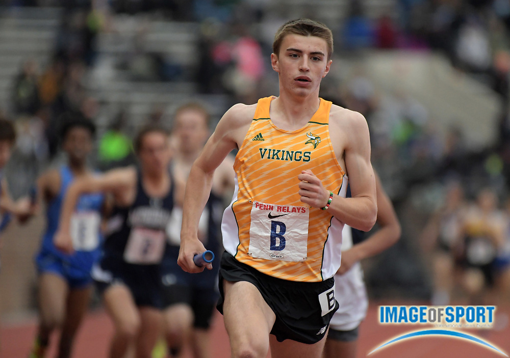 Apr 27, 2018; Philadelphia, PA, USA; Sam Affolder of Loudoun Valley (Va) leads the 1,600m anchor in the Championship of America boys distance medley relay during the 124th Penn Relays at Franklin Field.
