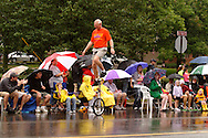 A unicyclist from St. Jacob Lutheran Church in Miamisburg performs during the 2012 Holiday at Home Parade on Far Hills Avenue in Kettering, Monday, September 3, 2012.
