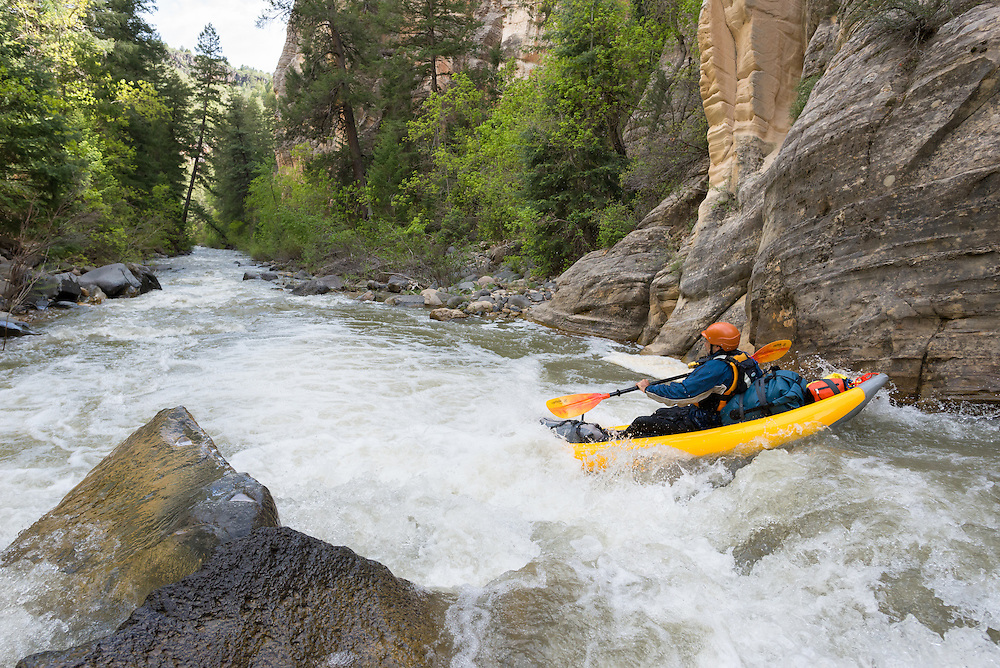 Paddling Deep Creek, Utah in an inflatable kayak.