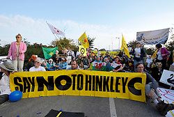© Licensed to London News Pictures. 28/07/2016. Hinkley Point, Somerset, UK.  A final investment decision is expected today from French energy company EDF to go ahead with the building of Hinkley C nuclear power plant, the first nuclear power plant to be built in the UK for 20 years, which will be built next to the existing Hinkley A and B nuclear plants. FILE PICTURE dated 03 October 2011; Demonstration against building a new nuclear power station, Hinkley C, at Hinkley Point in Somerset.  French company EDF plans to build the new power station.  Protestors blocked the gates from sunrise, and most workers at the plant were told not to come in. Photo credit : Simon Chapman/LNP