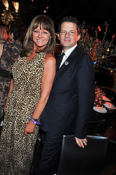 CAROLE LANGTON and GEORGE DUFFIELD at the Wild for WSPA dinner in aid of the charity World Society for the Protection of Animals held at Under The Bridge, Stamford Bridge, Fulham Road, London on 23rd February 2012.