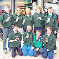 18 March 2013; Members of the Irish Judo squad who returned from an International Tournament in Owicz, Poland, winning 3 Gold and 6 Bronze medals, back, from left, Kevin Lawless, Tuam, Co. Galway, Roisin Cunningham Smyth, Galway, Ciara Cahill, Ennis, Co. Clare, Aaron Mannion Edwards, Galway, and Ciaran Weldon, Galway, with, front, from left, Stephen Flaherty Kelly, Galway, Roman Romanchuk, Dublin, Simon Maksimchyk, Dublin, Olivia Walsh, Galway. Terminal 2, Dublin Airport, Dublin. Picture credit: Brendan Moran / SPORTSFILE
