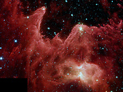 False-colour image from NASA's Spitzer Space Telescope shows the  formation of stars. Towering pillars of cool gas and dust are illuminated at their tips with light from warm embryonic stars. This inra-red picture shows pillars in the region called W5, in the Cassiopeia constellation 7,000 light-years away and 50 light-years across. The red colour in the Spitzer image represents organic molecules known as polycyclic aromatic hydrocarbons. These building blocks of life are often found in star-forming clouds of gas and dust.