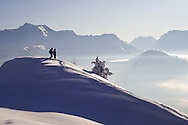 Skier and Snowboarder taking in the view. Alpe D'Huez, France