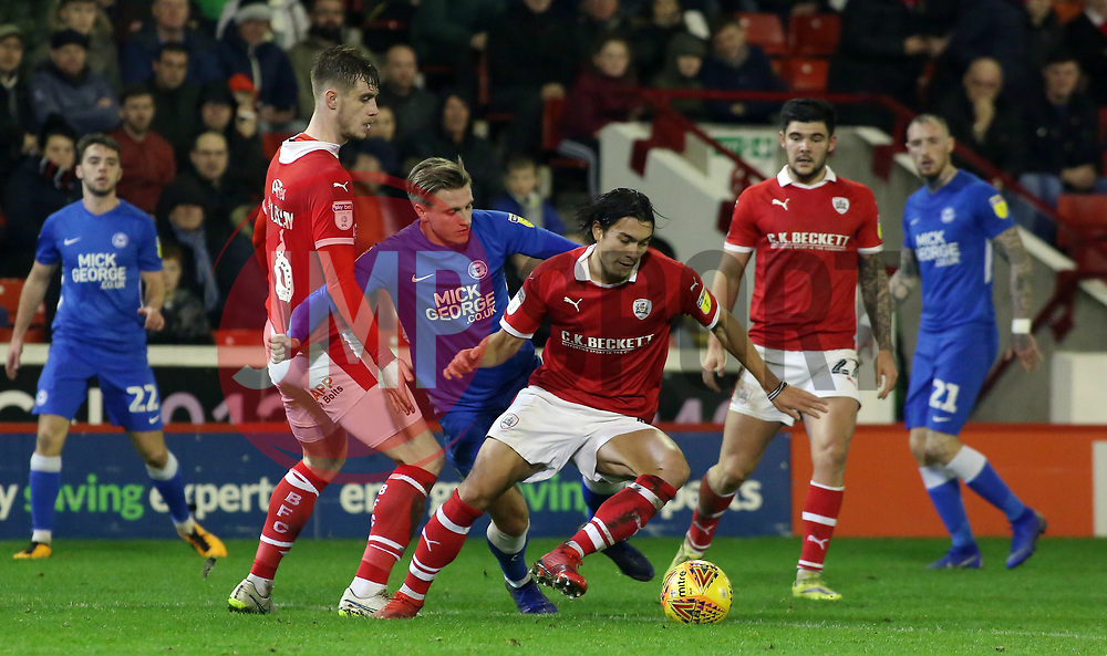 Jason Cummings of Peterborough United in action with Liam Lindsay and Kenny Dougall of Barnsley - Mandatory by-line: Joe Dent/JMP - 26/12/2018 - FOOTBALL - Oakwell Stadium - Barnsley, England - Barnsley v Peterborough United - Sky Bet League One