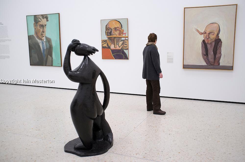 Visitor looking at paintings at new contemporary  art museum or GEGENWARTSKUNST at Stadel museum in Frankfurt Germany