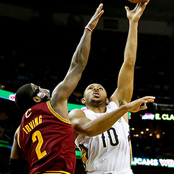 Nov 22, 2013; New Orleans, LA, USA; New Orleans Pelicans shooting guard Eric Gordon (10) shoots over Cleveland Cavaliers point guard Kyrie Irving (2) during the second quarter of a game at New Orleans Arena. Mandatory Credit: Derick E. Hingle-USA TODAY Sports