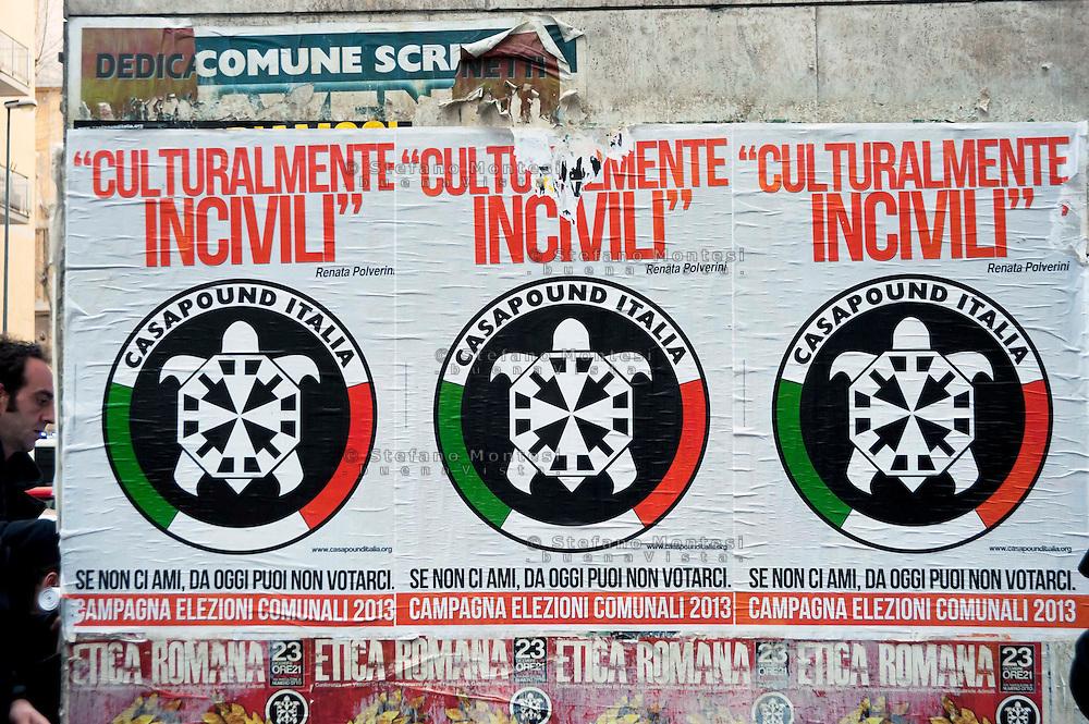 Roma 24 Marzo 2012.Conferenza stampa ai Magazzini popolari e corteo antifascista a Casalbertone dopo l'aggressione  di ieri da parte di militanti di Casa Pound..I manifesti di Casa Pound  su un muro di Casalbertone