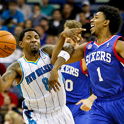 November 7, 2012; New Orleans, LA, USA; New Orleans Hornets shooting guard Roger Mason Jr. (8) and Philadelphia 76ers shooting guard Nick Young (1) get tied up in a scramble for a loose ball during the second half of a game at the New Orleans Arena. The 76ers defeated the Hornets 77-62. Mandatory Credit: Derick E. Hingle-US PRESSWIRE