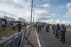 April 28, 2017 - Brasilia, Brazil - Armed police stand in line as people gather for a peaceful protest near the Brazilian Congress in Brasilia, Brazil on April 28, 2017, the day of a nationwide workers strike in Brazil. (Credit Image: © Osvaldo Ribeiro Filho/NurPhoto via ZUMA Press)