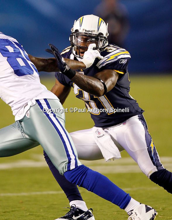 San Diego Chargers free agent cornerback Nathan Vasher (31) has his facemask pulled by a receiver as he drops back in pass coverage during a NFL week 2 preseason football game against the Dallas Cowboys on Saturday, August 21, 2010 in San Diego, California. The Cowboys won the game 16-14. (©Paul Anthony Spinelli)