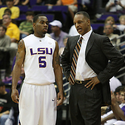 14 February 2009 LSU Tigers head coach Trent Johnson talks with Marcus Thornton (5) during a NCAA basketball game between SEC rivals the Ole Miss Rebels and the LSU Tigers at the Pete Maravich Assembly Center in Baton Rouge, LA.