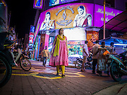 "20 DECEMBER 2012 - KUALA LUMPUR, MALAYSIA: Women walk past a dress shop on Jalan Tun Sambanthan, the main street in ""Brickfields,"" the Little India section of Kuala Lumpur, Malaysia. The ""Little India"" section of Kuala Lumpur is also known as ""Brickfields."" The area has recently been renovated and has emerged as a tourist draw. It's within walking distance of KL Stesen Sentral, the Kuala Lumpur central train station.    PHOTO BY JACK KURTZ"