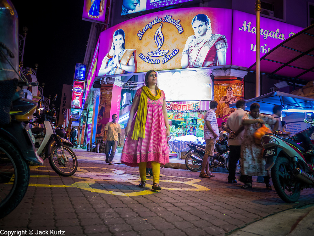 """20 DECEMBER 2012 - KUALA LUMPUR, MALAYSIA: Women walk past a dress shop on Jalan Tun Sambanthan, the main street in """"Brickfields,"""" the Little India section of Kuala Lumpur, Malaysia. The """"Little India"""" section of Kuala Lumpur is also known as """"Brickfields."""" The area has recently been renovated and has emerged as a tourist draw. It's within walking distance of KL Stesen Sentral, the Kuala Lumpur central train station.    PHOTO BY JACK KURTZ"""