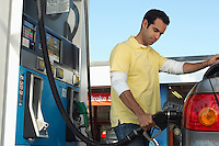 Man pumping gas