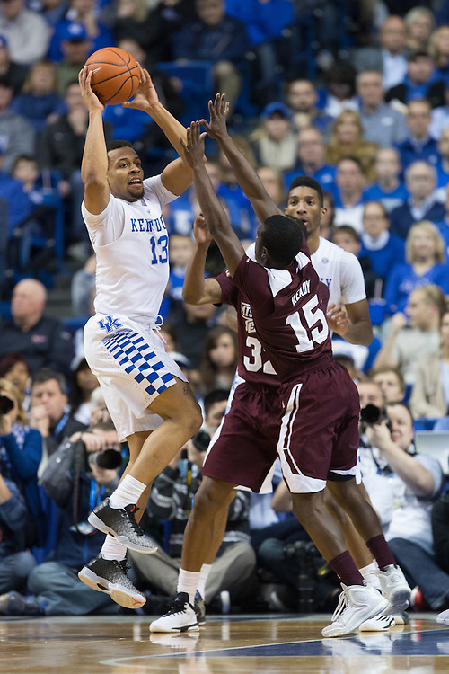 Kentucky guard Isaiah Briscoe, left, looks for an open teammate in the first half. The University of Kentucky hosted Mississippi State, Tuesday, Jan. 12, 2016 at Rupp Arena in Lexington.