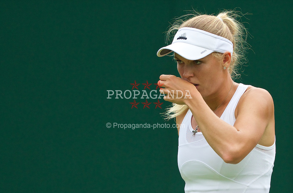 LONDON, ENGLAND - Monday, June 23, 2014: Caroline Wozniacki (DEN) during the Ladies' Singles 1st Round match on day one of the Wimbledon Lawn Tennis Championships at the All England Lawn Tennis and Croquet Club. (Pic by David Rawcliffe/Propaganda)
