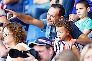 01-08-2015 VOETBAL: WILLEM II - SIVASSPOR:TILBURG<br /> Vriendschappelijke wedstrijd van Willem II op de Koningsdag 2015<br /> <br /> Vader met zijn zoon - jonge supporter - op de tribune <br /> <br /> <br /> Foto: Geert van Erven