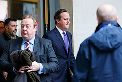 © Licensed to London News Pictures. 04/01/2015. LONDON, UK. Prime Minister David Cameron leaving BBC Broadcasting House in London after taking part on the The Andrew Marr show on BBC One on Sunday, 4 January 2014. Photo credit : Tolga Akmen/LNP