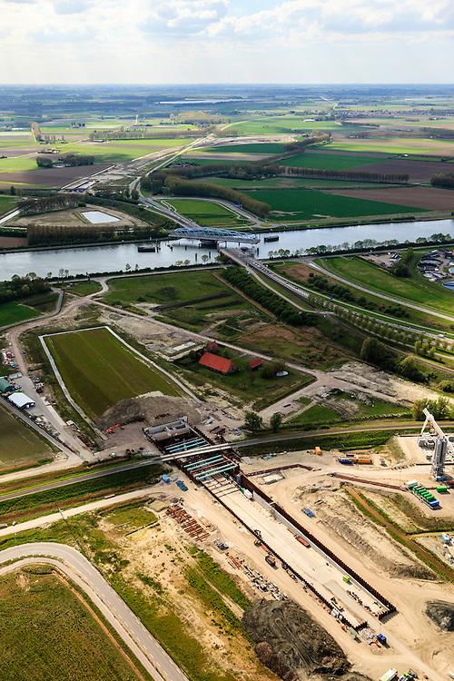 Nederland, Zeeland, Zeeuws-Vlaanderen, 09-05-2013; Sluiskil, Kanaal Gent-Terneuzen, kanaalkruising Sluiskil. Bouwpunt van de tunnel.<br /> De brug in de N61 sluit zeer regelmatig voor zeeschepen en dit veroorzaakt files. Daarom zal de kanaalbrug vervangen worden door een tunnel, de Sluiskiltunnel (oplevering 2015).<br /> The pivot bridge over the canal Gent-Terneuzen (Zeeland) closes very regularly for seagoing vessels and this causes traffic jams. Therefore, the canal bridge will be replaced by a tunnel, the tunnel Sluiskil (completion 2015).<br /> luchtfoto (toeslag op standard tarieven);<br /> aerial photo (additional fee required);<br /> copyright foto/photo Siebe Swart.