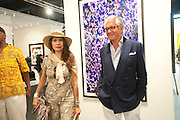 CASSANDRA CAVA; GEORGE HAMILTON; , Opening of Art Basel Miami Beach. Convention Centre.  Miami Beach. 30 November 2010. -DO NOT ARCHIVE-© Copyright Photograph by Dafydd Jones. 248 Clapham Rd. London SW9 0PZ. Tel 0207 820 0771. www.dafjones.com.
