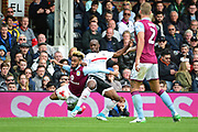 Fulham striker Sone Aluko (24) tackles Aston Villa defender Jordan Amavi (23) during the EFL Sky Bet Championship match between Fulham and Aston Villa at Craven Cottage, London, England on 17 April 2017. Photo by Jon Bromley.