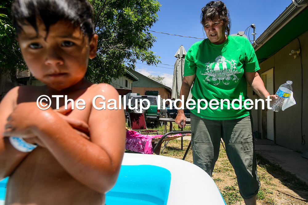 Leona Loisolle plays with her grandson Ian Samora, 5, Wednesday in Gallup. Loisolle recently moved in Gallup into her father's house after he passed away in August.