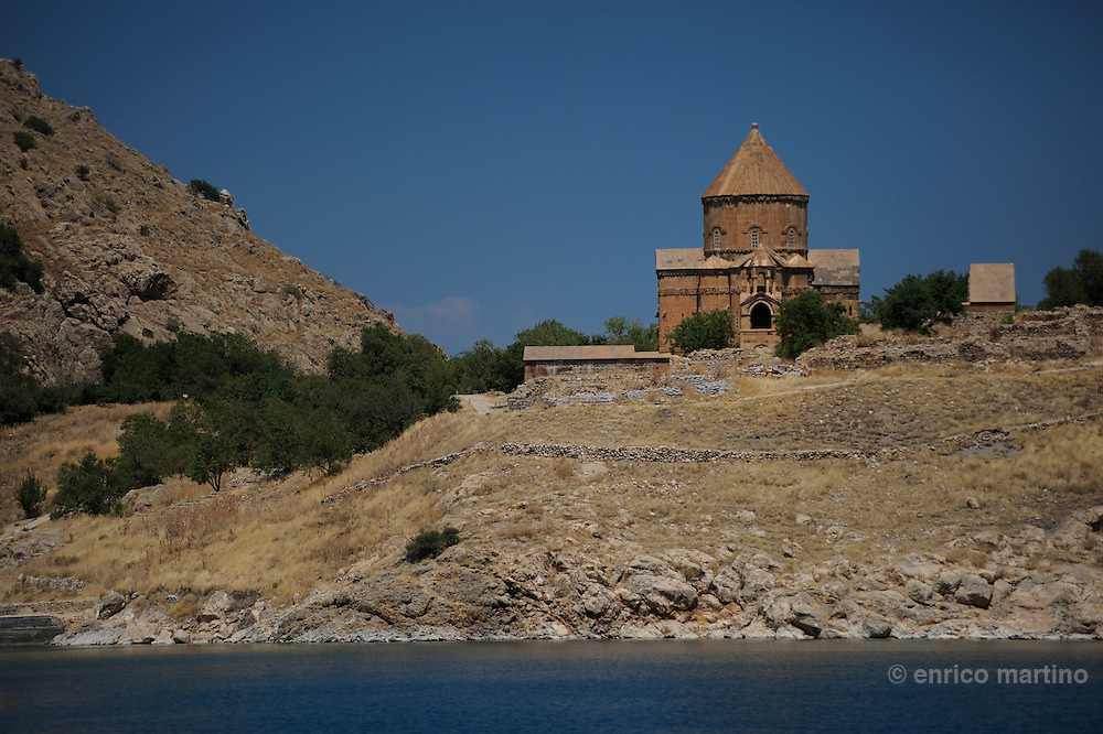 Northeastern Anatolia. Van Lake. Akdamar Island  is the home to a tenth century Armenian church, known as the Cathedral Church of the Holy Cross (915-921), was the seat of an Armenian Catholicos from 1116 to 1895. Armenian King Gagik I Artsruni (908-944) chose Agt'hamar (the Armenian name of the island) as one of his residences. The only surviving structure is the Palatine Cathedral of the Holy Cross built by the architect-monk Manuel.<br /> The unique importance of the Cathedral Church of the Holy Cross comes from the extensive array of bas-relief carving of mostly biblical scenes that adorn its external walls. The meanings of these reliefs have been the subject of much and varied interpretation.