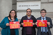 Lorna Merry, Dan Ingreji,Craig Mason, HMRC, 100 Parliament Street. PCS members working in the civil service are holding a short, high profile protest to demonstrate about the continued 1% pay cap public sector pay cap that has been in place for 7 years.Westminster,  London,  United Kingdom. (Photo by Andy Aitchison / PCS)
