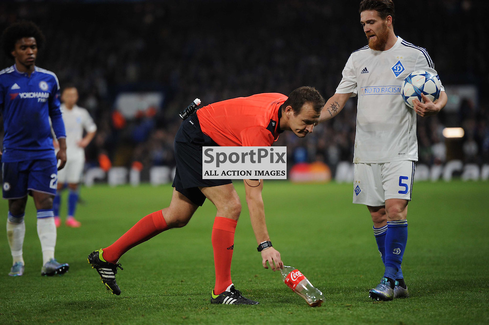 Referee Pavel Kralovec deals with some rubbish thrown onto the pitch during the Chelsea v Dynamo Kiev champions league match in the group stage on the 4th November 2015