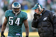 Linebacker Jeremiah Trotter of the Philadelphia Eagles talks with defensive coordinator Jim Johnson during the 2005 NFC Championship.