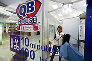 Silom Road. 10-minute-haircut at QB house.